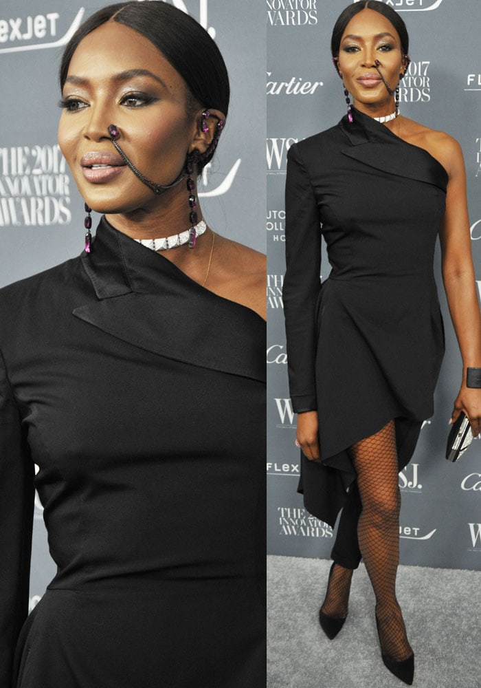 Naomi arrives in a deconstructed jumpsuit by Jean Paul Gaultier