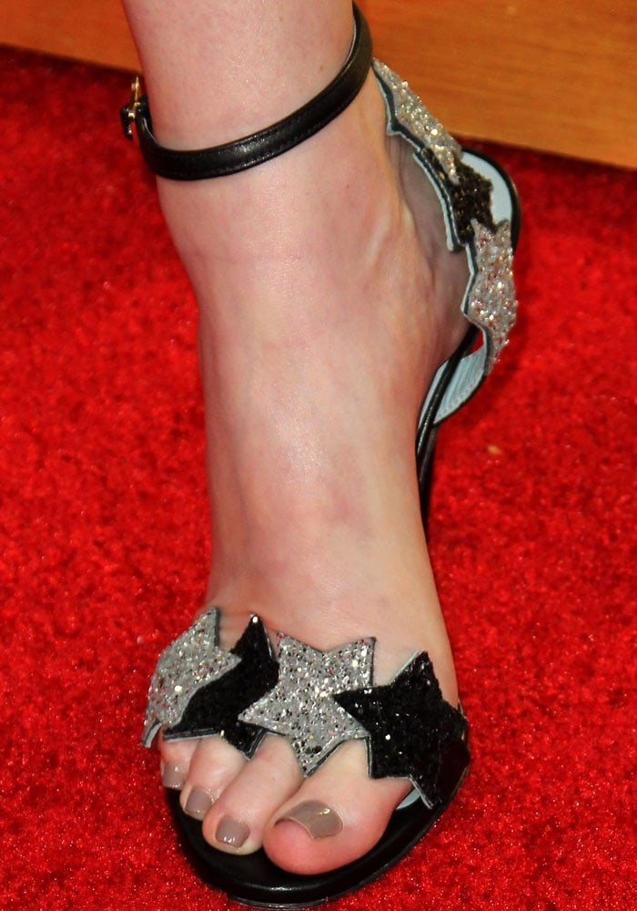 "Whitney slipped her perfectly pedicured feet into a pair of Chiara Ferragni ""Star"" stilettos"