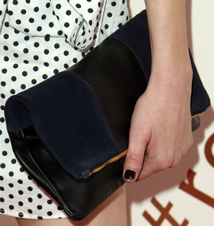 Whitney accessorized with a foldover clutch by Clare V
