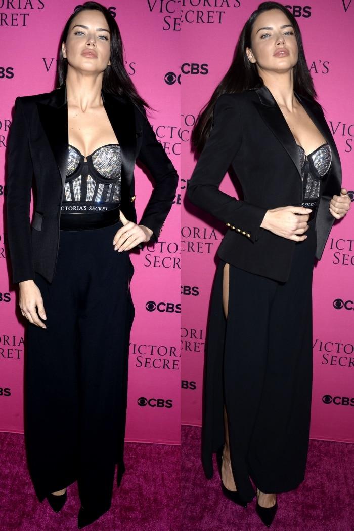 "Adriana Lima wearing Victoria's Secret x Balmain blazer, Victoria's Secret x Swarovski studded bra, and Stuart Weitzman ""Curvia"" pumps"