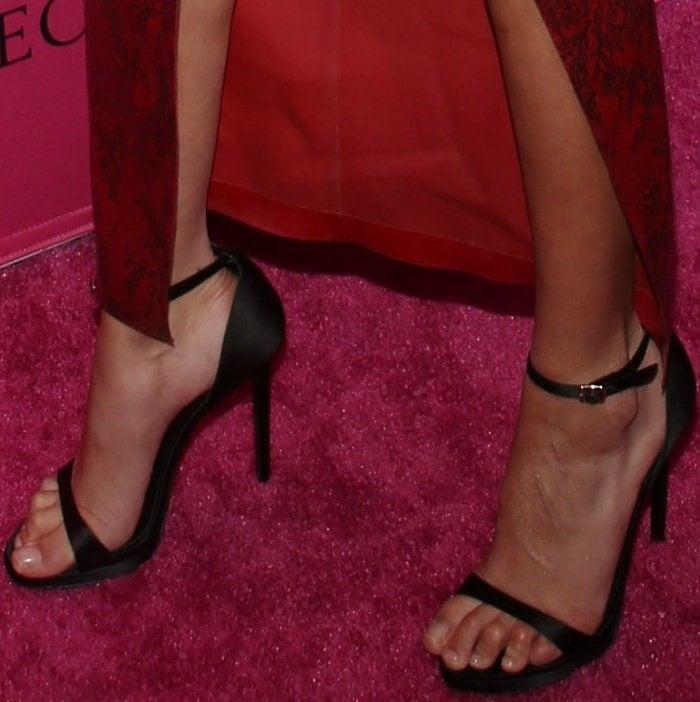 "Bella Hadid wearing black Stuart Weitzman ""Nudistsong"" sandals"
