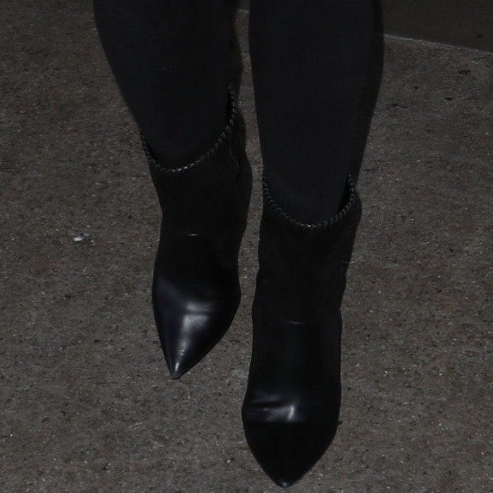 Chrissy Teigen wears jeans with mixed leather mid-calf boots