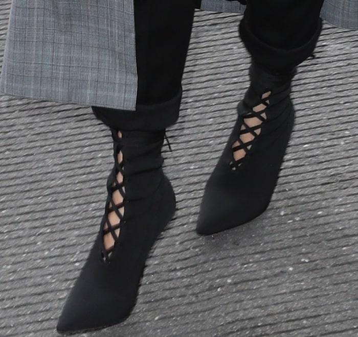 Chrissy Teigen rocks Yeezy Season 5 lace-up boots