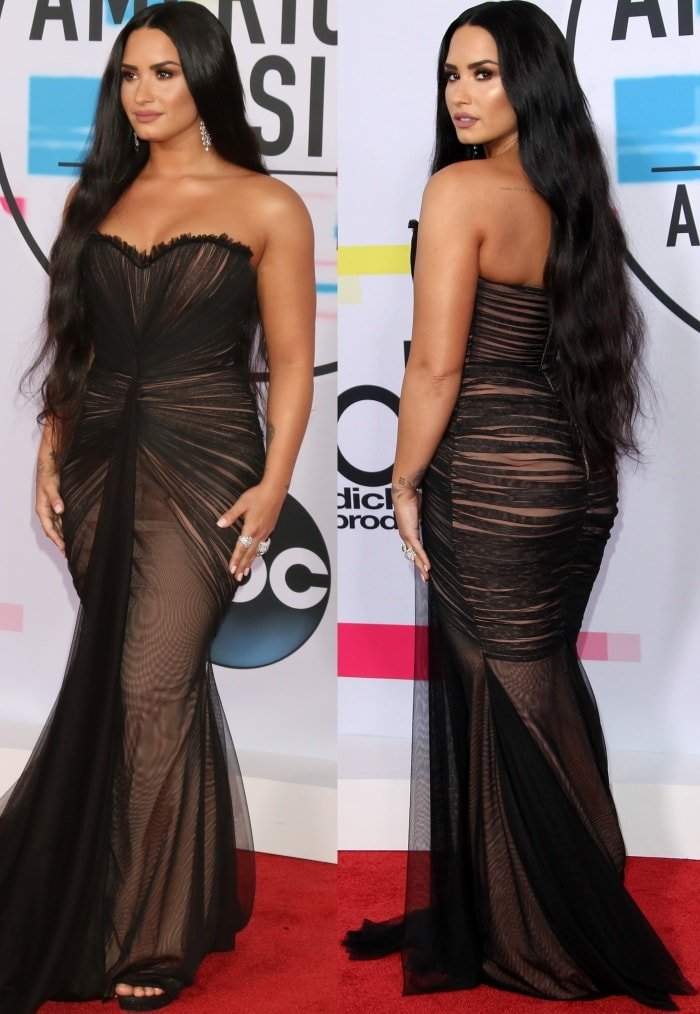Demi Lovato wearing a black Ester Abner Spring 2018 gown and Stuart Weitzman sandals at the 2017 American Music Awards