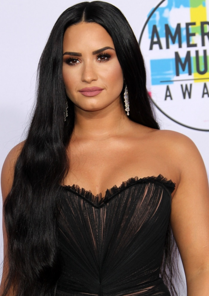 Demi Lovato wearing a black Ester Abner Spring 2018 gown at the 2017 American Music Awards