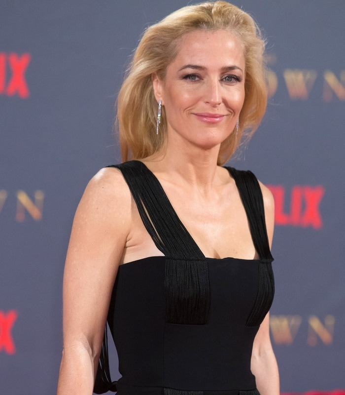 "Gillian Anderson wearing a Galvan Resort 2018 jumpsuit at Netflix's ""The Crown"" Season 2 world premiere"