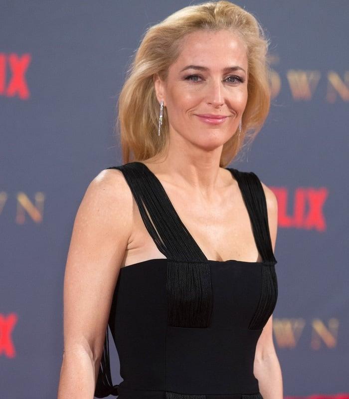 "Gillian Anderson wearing a Galvan Resort 2018 jumpsuit at Netflix's ""The Crown"" Season 2 world premiere"