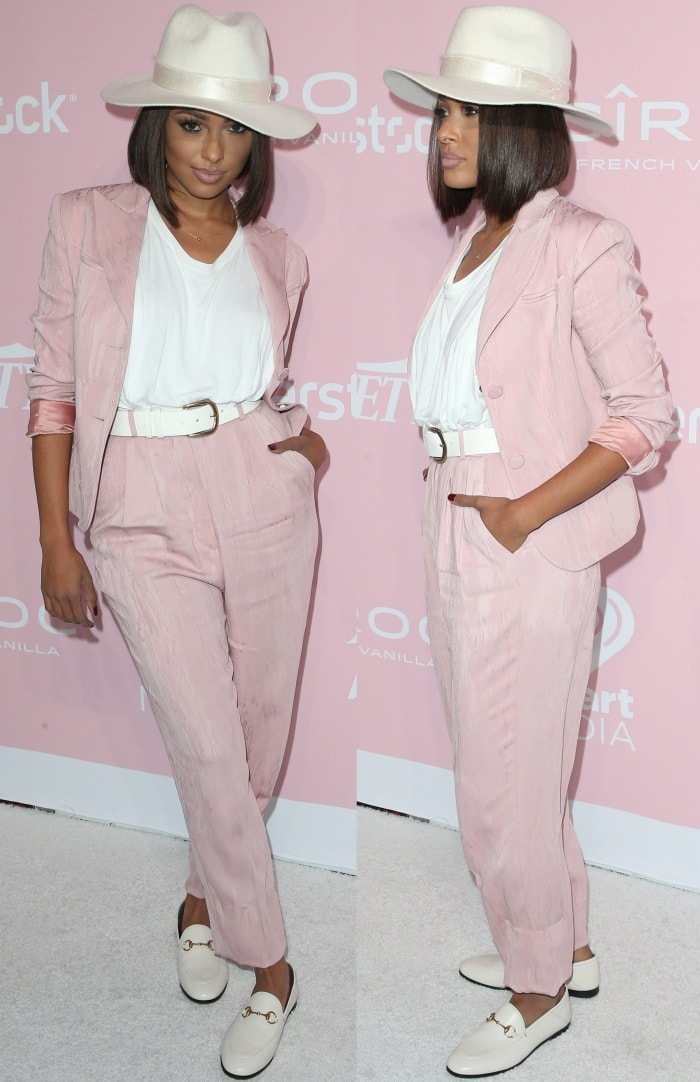 "Kat Graham wearing a John Galliano suit and Gucci ""Brixton"" loafers at Variety's 1st Annual Hitmakers Luncheon"
