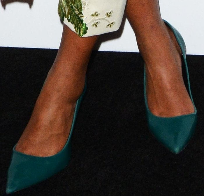 """Laura Harrier wearing green suede pumps at the Bulgari """"From Rome to NYC"""" party"""