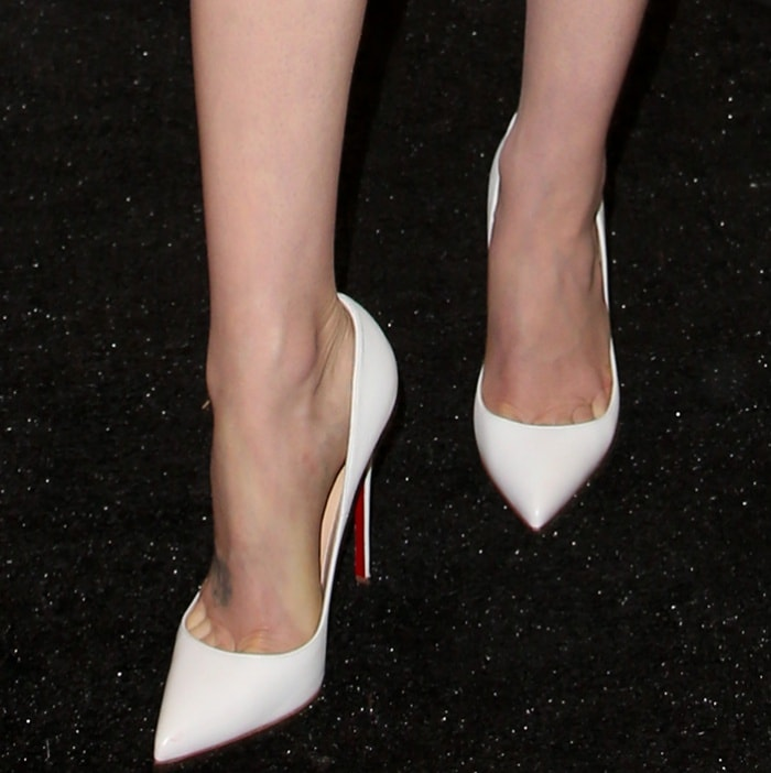Lily Collins wearing Christian Louboutin pointy-toe pumps at the 33rd Film Independent Spirit Awards nominations press conference