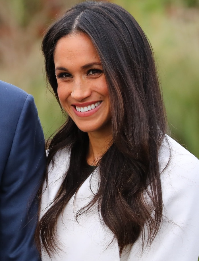"Meghan Markle wearing a Line coat, a P.A.R.O.S.H. dress and Aquazzura ""Matild"" pumps"