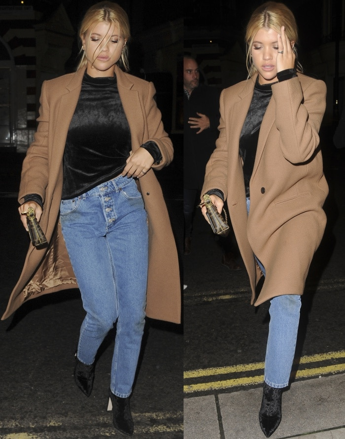 "Sofia Richie wearing a Theory coat and turtleneck top, Balenciaga ""Tube"" jeans, and black velvet pointy-toe boots while out and about in London"