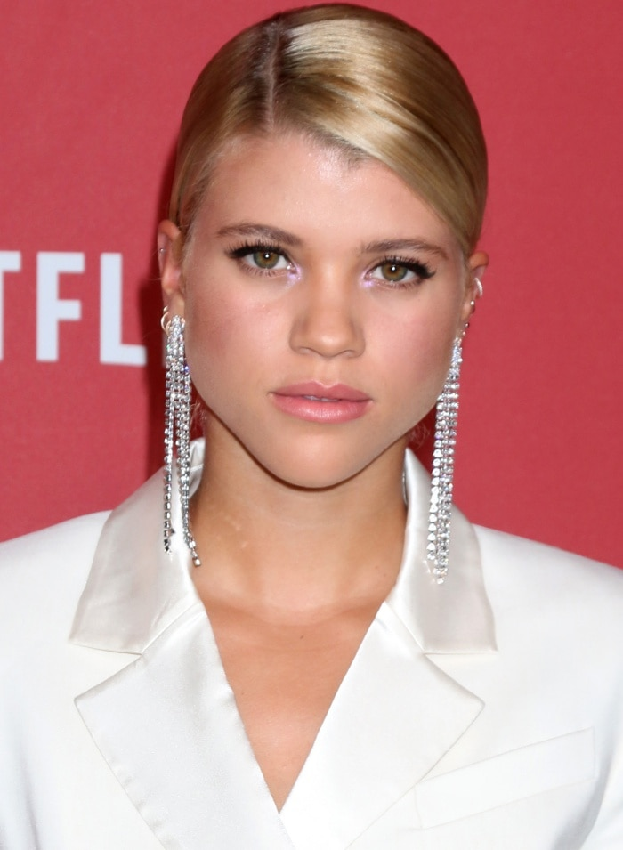 Sofia Richie wearing a Rachel Zoe ivory tuxedo dress and statement earrings at the SAG-AFTRA Foundation Patron of the Artists Awards