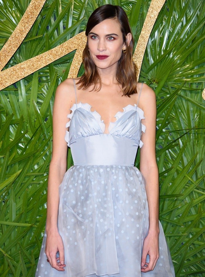 Alexa Chung looked like a mess in a pearly polka dot dress from her own label featuring spaghetti straps and a statement waist band