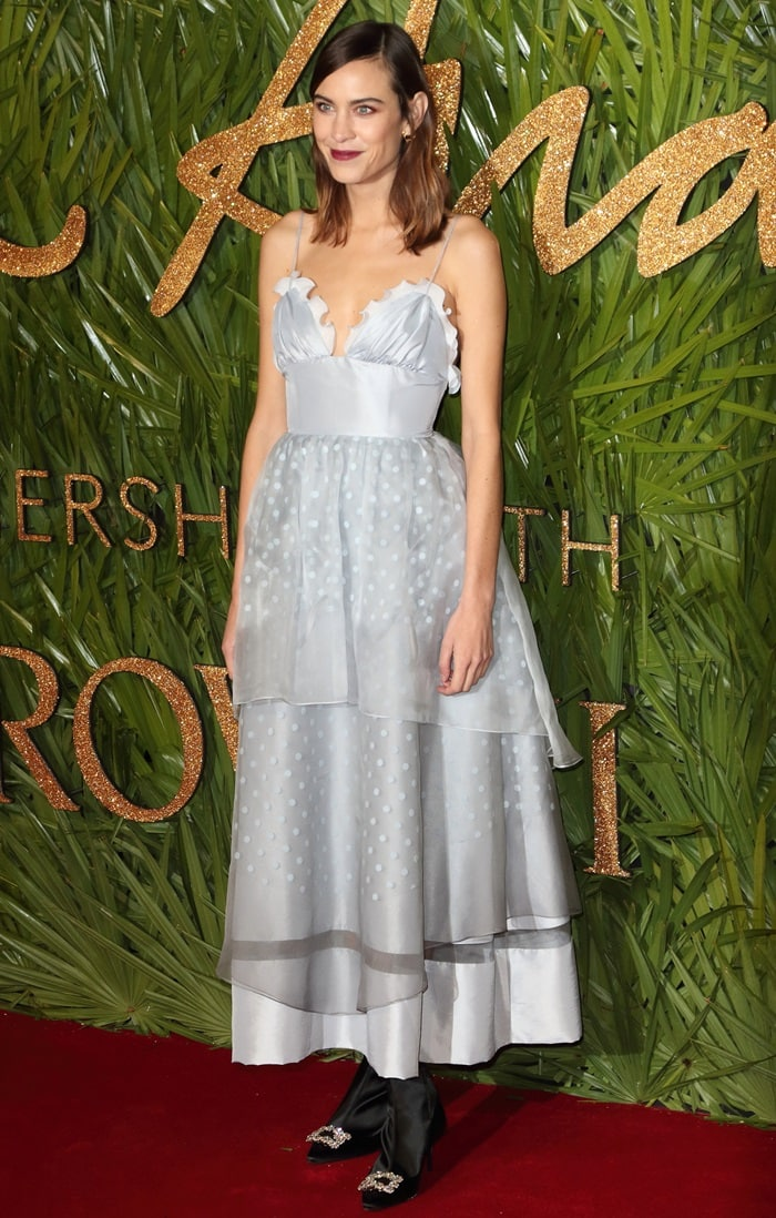 Alexa Chung wearing a monstrous ALEXACHUNG dress at the 2017 Fashion Awards held at Royal Albert Hall in London, England, on December 4, 2017