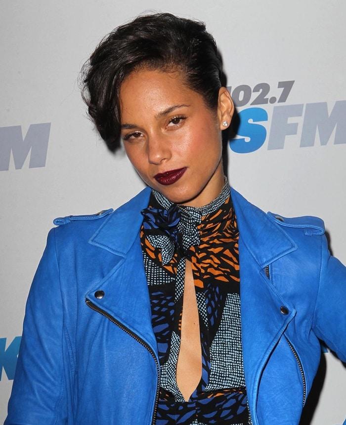 Alicia Keys wearing a light-blue leather moto jacket