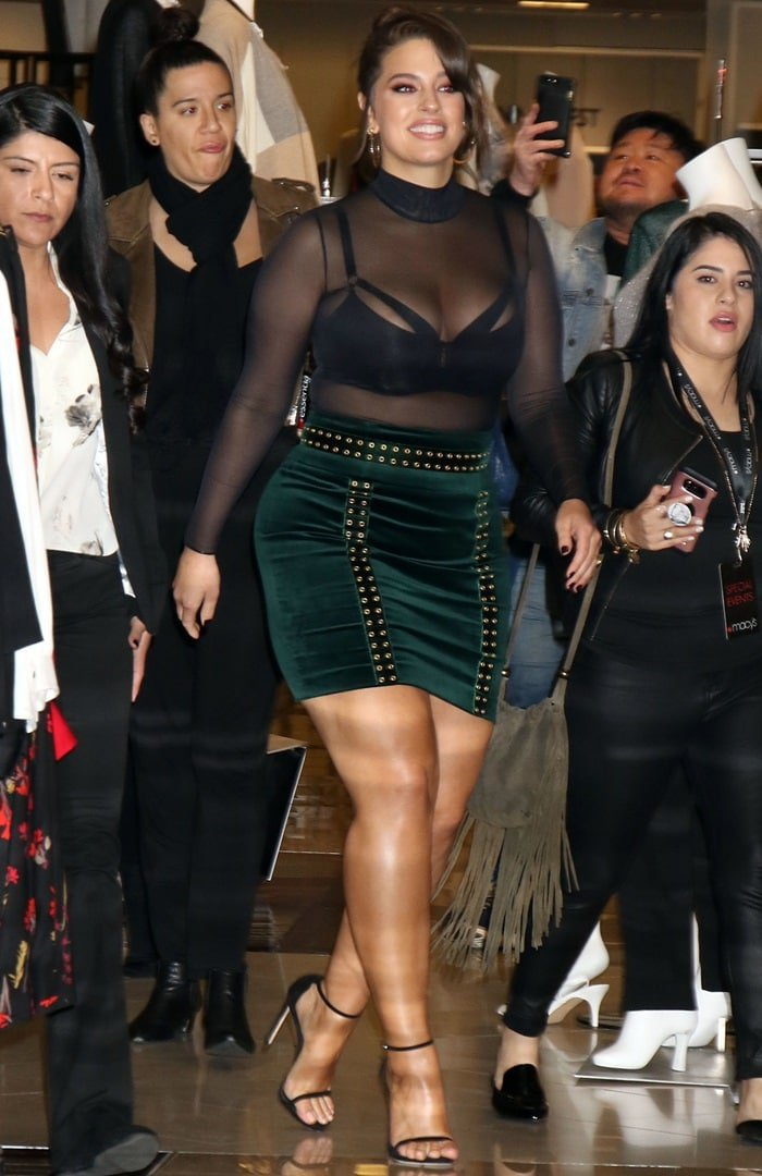 Model, Designer and Body-Positive Activist Ashley Graham completed her revealing ensemble with Jennifer Fisher jewelry and ankle-strap sandals from Stuart Weitzman