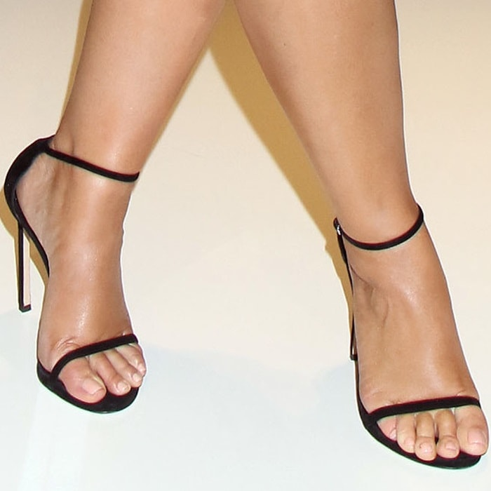 Model, Designer and Body-Positive Activist Ashley Graham showing off her feet in Stuart Weitzman sandals