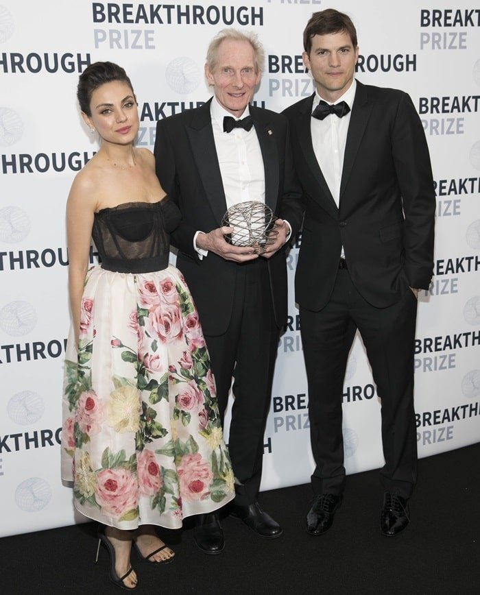 Professor Kim Nasmyth FRS, Whitley Professor of Biochemistry at the University of Oxford and Fellow of Trinity College, Oxford, posing with Ashton Kutcher and Mila Kunis