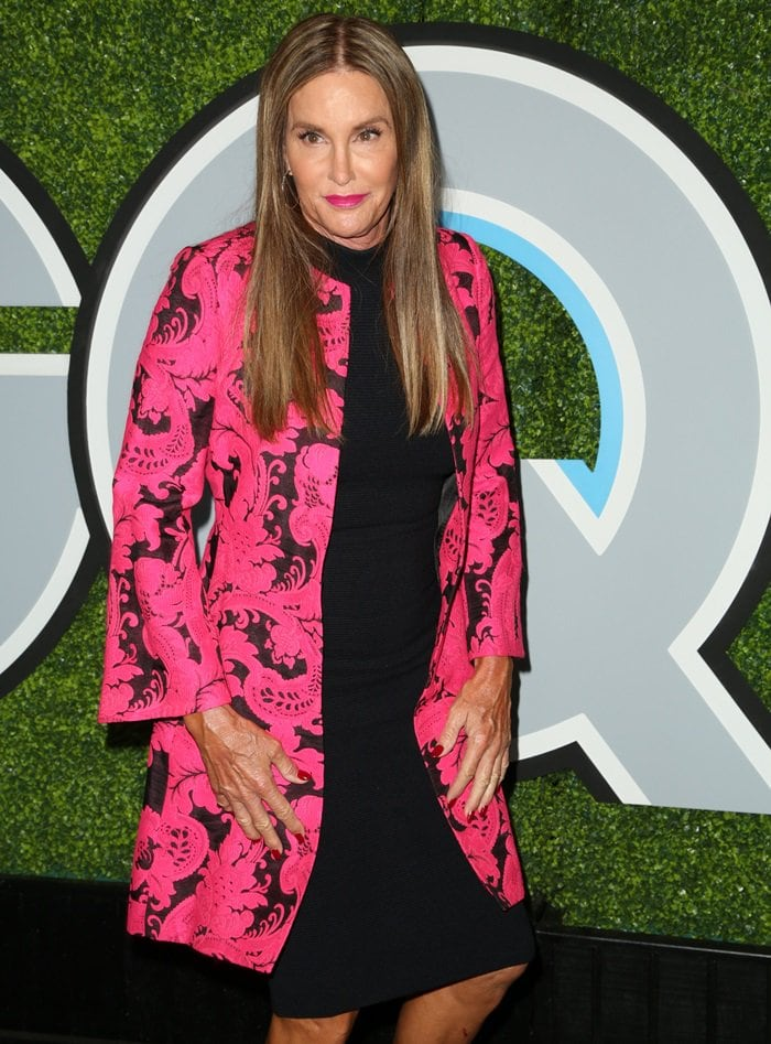 Caitlyn Jenner glittered in a hot pink and black jacket styled with a classic little black dress