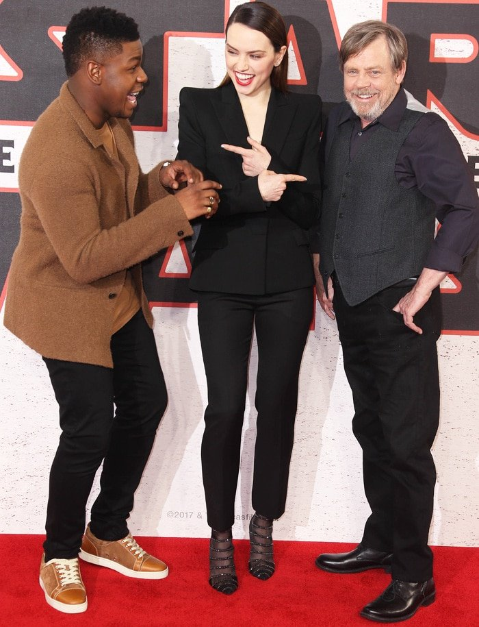 Daisy fools around with co-actors John Boyega and Mark Hamill