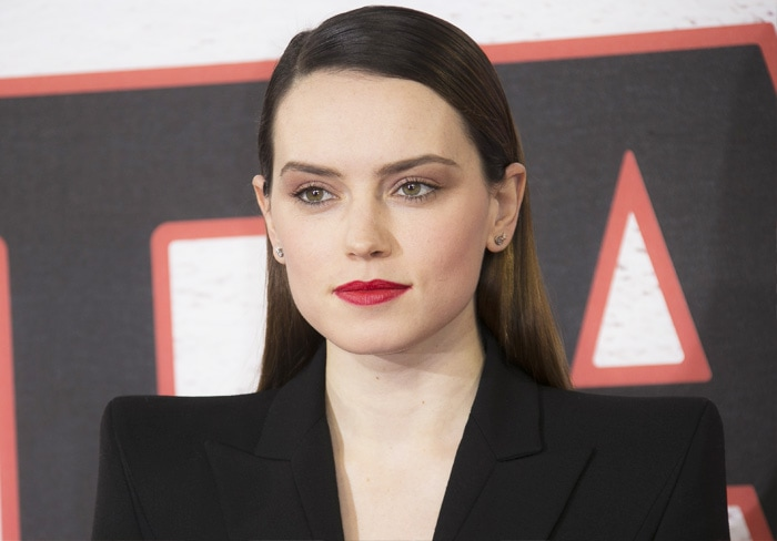 The actress puts on a vampy look with bold red lips
