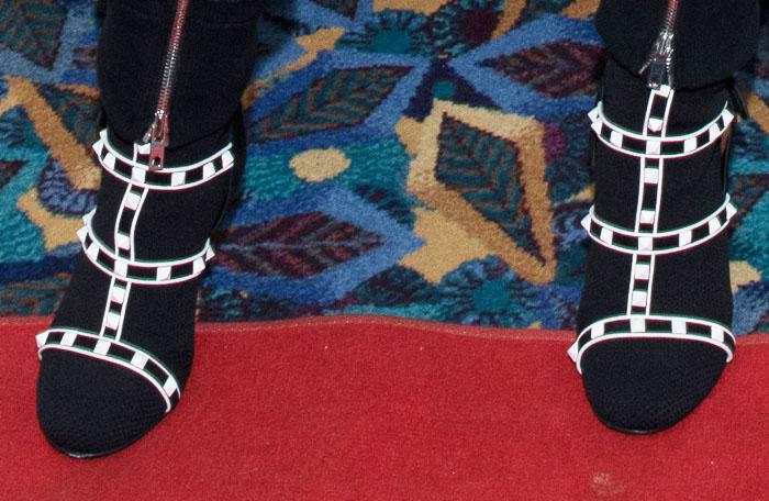 Demi looked futuristic in Valentino Rockstud Bodytech booties