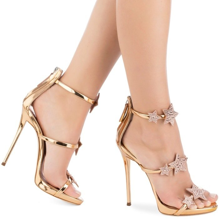These gold-tone metallic leather sandals feature an open toe, a strappy design, a high stiletto heel, a rear zip fastening, and studded star applique details