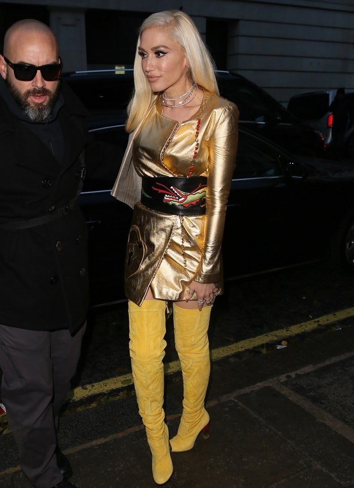 Gwen Stefani arrives at Radio 2 wearing an eye-catching yellow and gold Schiaparelli Spring 2017 Couture ensemble on December 1, 2017
