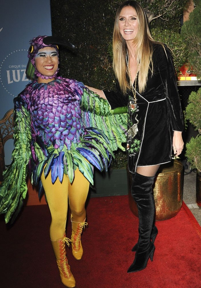 Heidi poses with a character from the Cirque du Soleil show