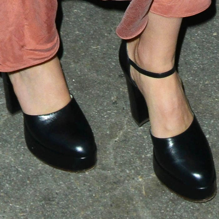 "The actress adds a few inches to her height with a pair of Gucci ""Agon"" pumps"