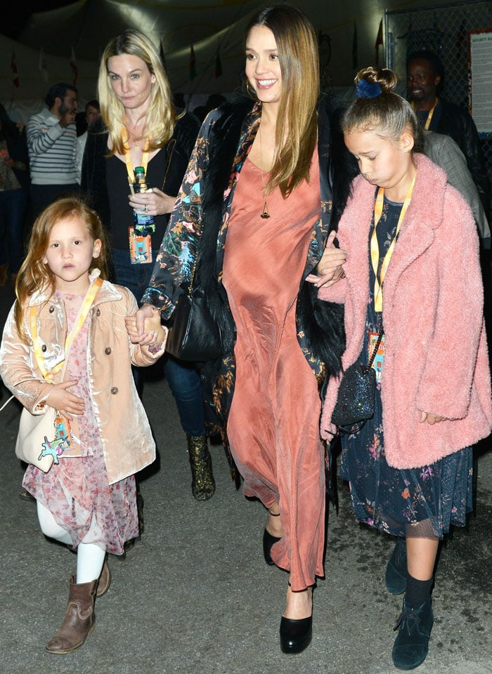 The actress enjoys a night out with her parents and children