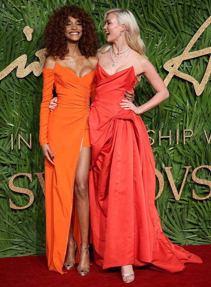 Karlie Kloss was joined on the red carpet by English fashion model Jourdan Dunn, who looked fabulous in a bright orange Versace dress styled with metallic heels
