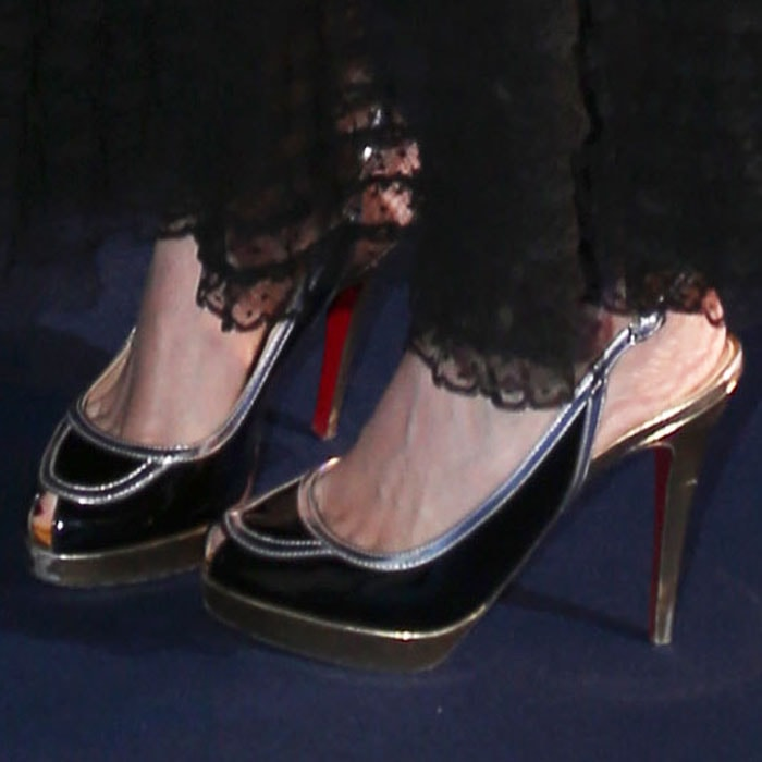 """The actress kept her look interesting with a pair of Christian Louboutin """"Fox Trot"""" sandals"""