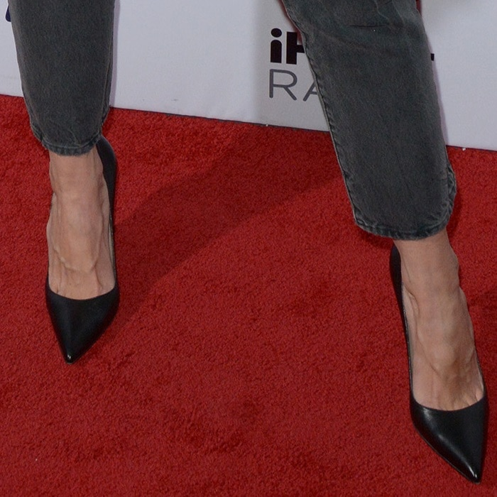 Katie Holmes wearing black pointy-toe pumps