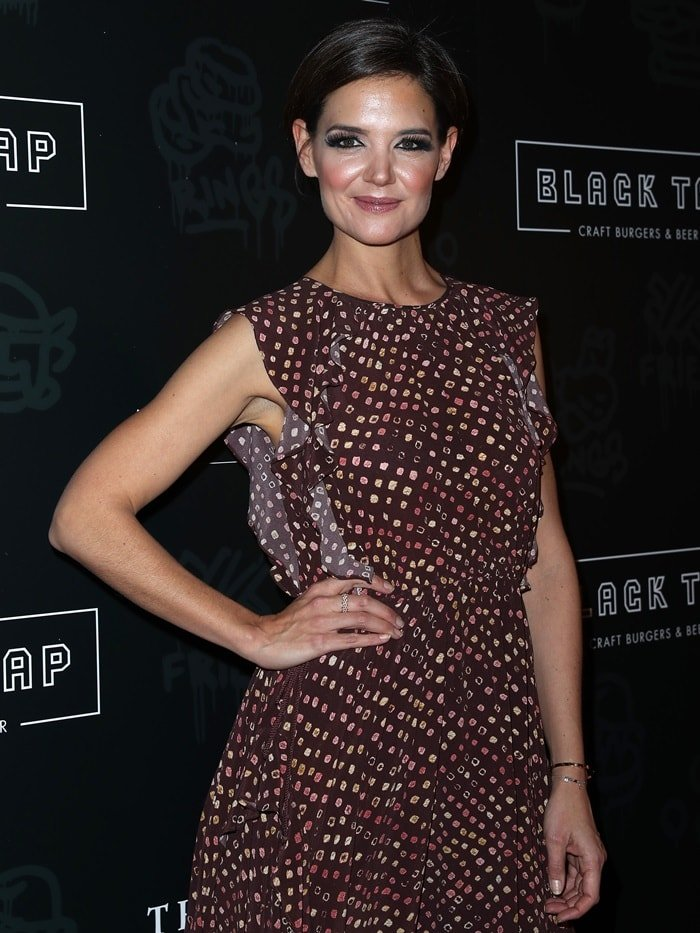 Katie Holmes wearing a ruffled Ulla Johnson dress at the grand opening of Black Tap Craft Burgers & Beer at The Venetian in Las Vegas on December 29, 2017