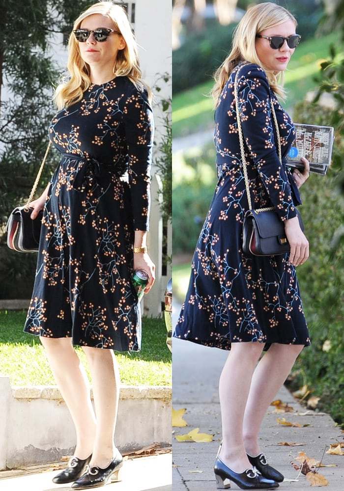 The soon-to-be-mom showed off her bump in a cherry print fit-and-flare dress