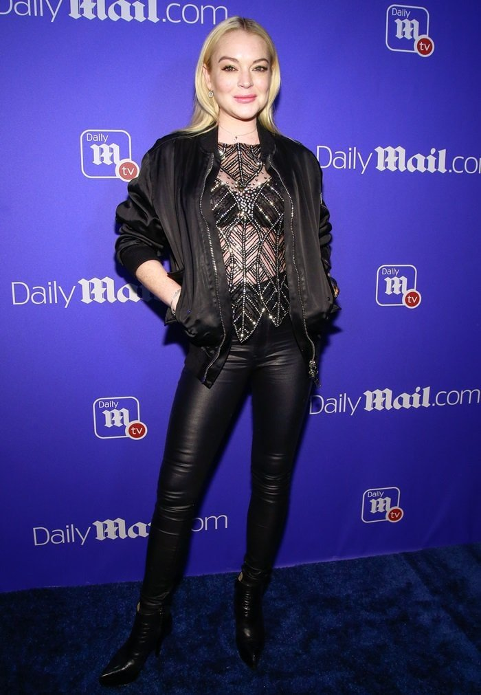 Lindsay Lohan did not leave much to the imagination in a sheer black stop studded with crystals, leather 'Edita' pants from J Brand, black boots, and a matching bomber jacket
