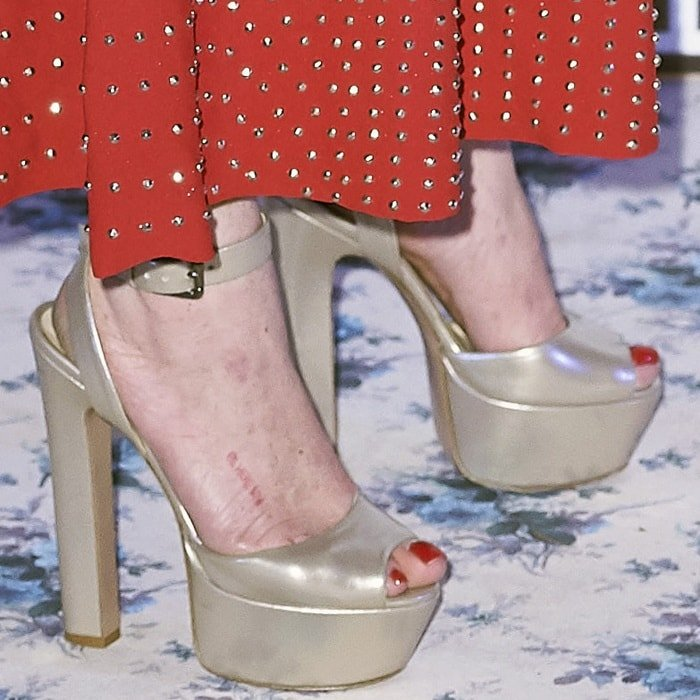 Lindsay Lohan showing off her feet in peep-toe platform pumps