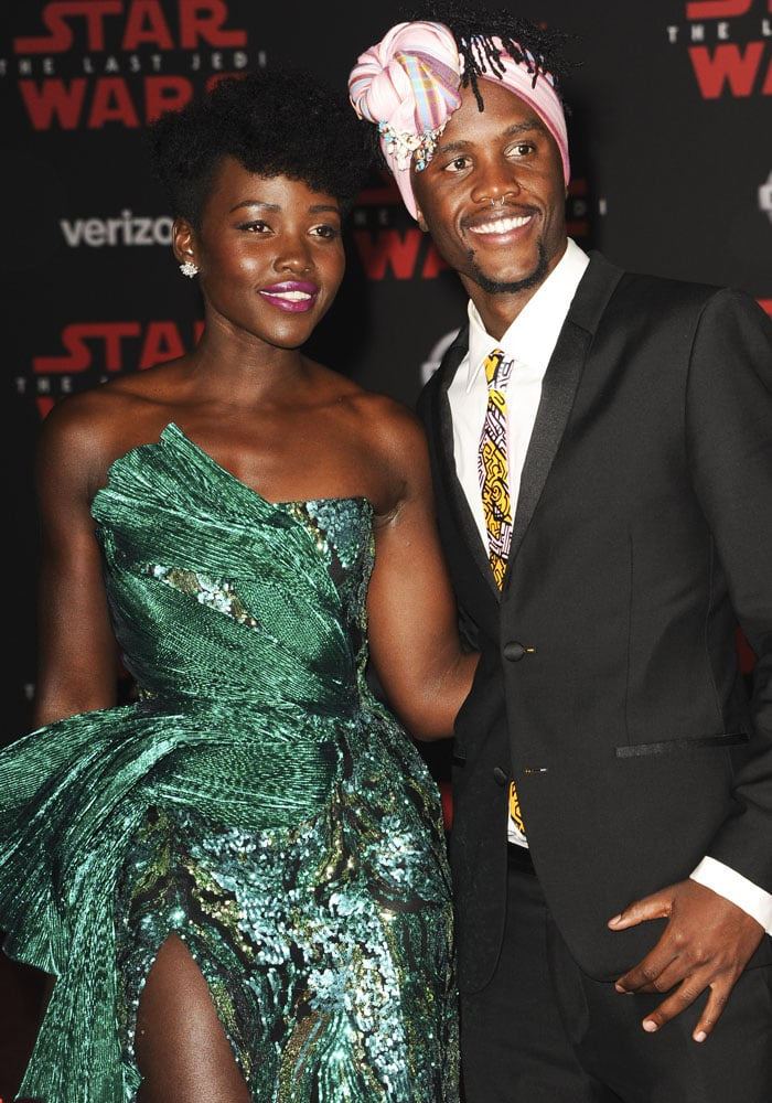 Lupita brings her brother Peter Nyong'o along to the movie premiere