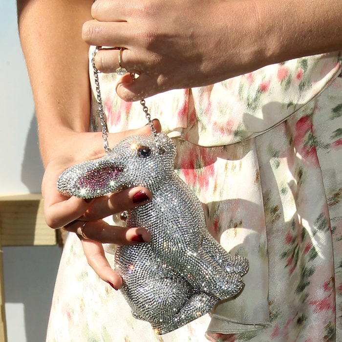 Margot Robbie toting a Judith Leiber Couture hard-shell minaudiere clutch bag in bunny shape