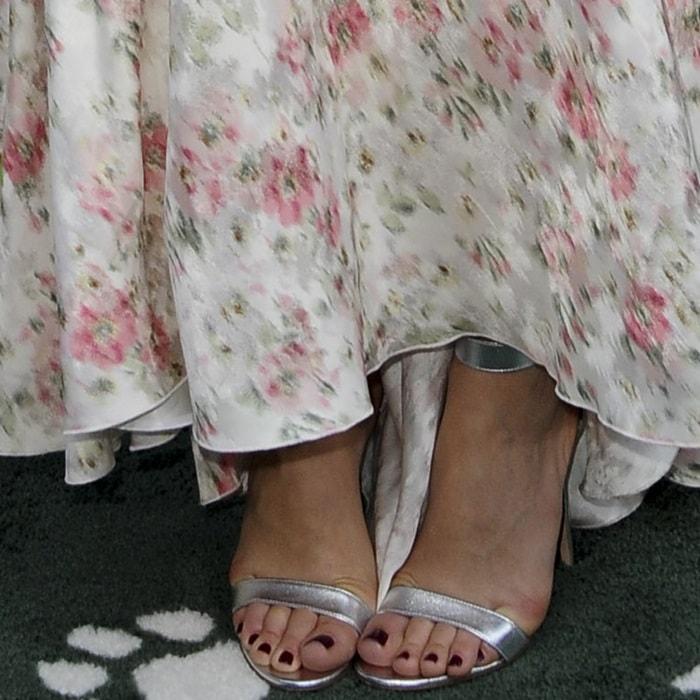 Margot Robbie showing off her feet in silver Gianvito Rossi 'Portofino' sandals