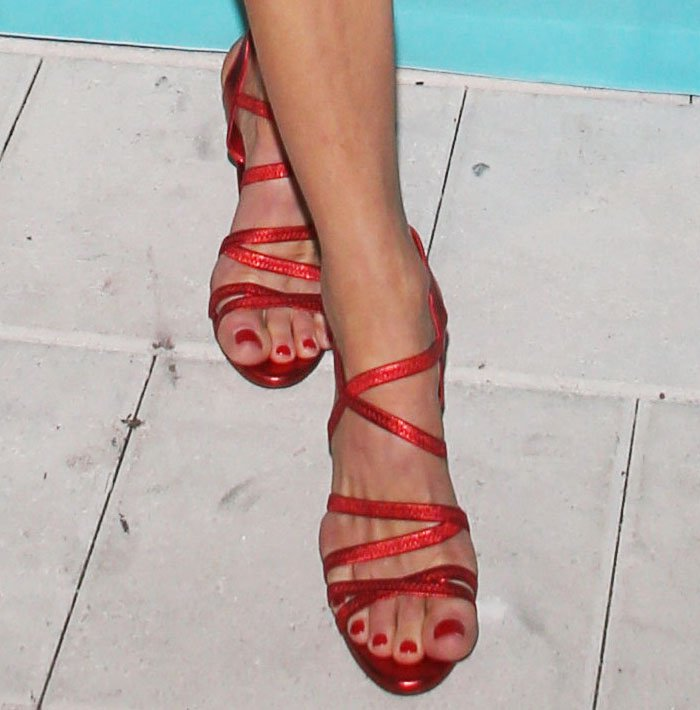 """Martha adds a pop of holiday cheer into her look with a pair of By FAR """"Berta"""" sandals"""