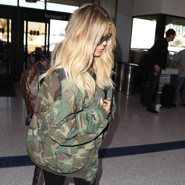 Pregnant Khloe Kardashian arriving at the airport and making her way to her flight