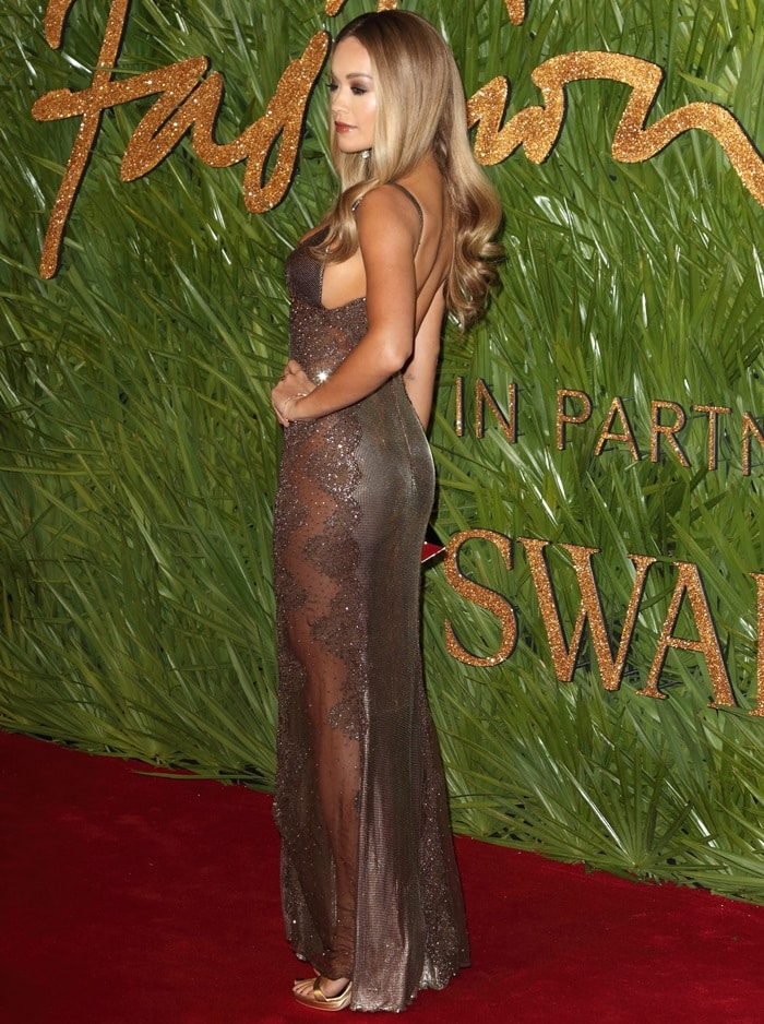 Rita Ora wearing a vintage Versace dress at the 2017 Fashion Awards held at Royal Albert Hall in London, England, on December 4, 2017