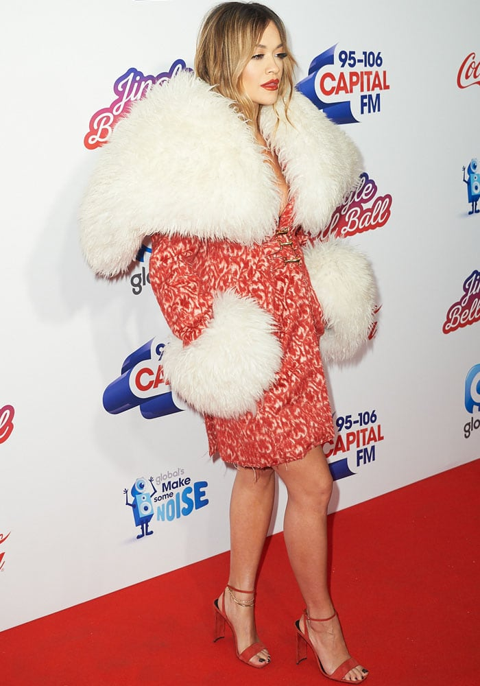 Rita keeps herself warm under a generous layer of faux fur