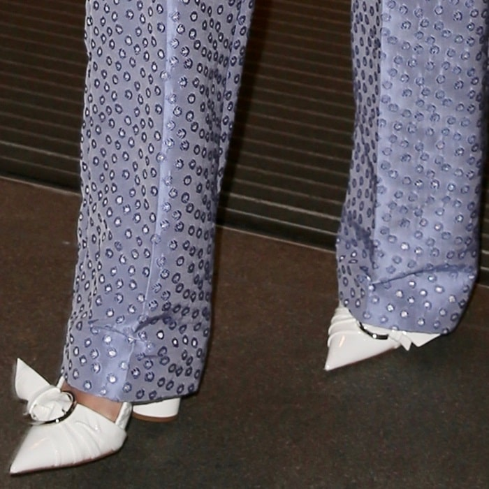 Rita Ora rocking white Dior patent calfskin pointy-toe pumps