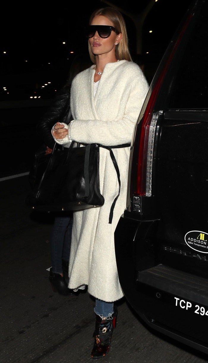 Rosie Huntington-Whiteley heading into the airport wearing a long white Isabel Marant teddy bear coat in Los Angeles on December 5, 2017