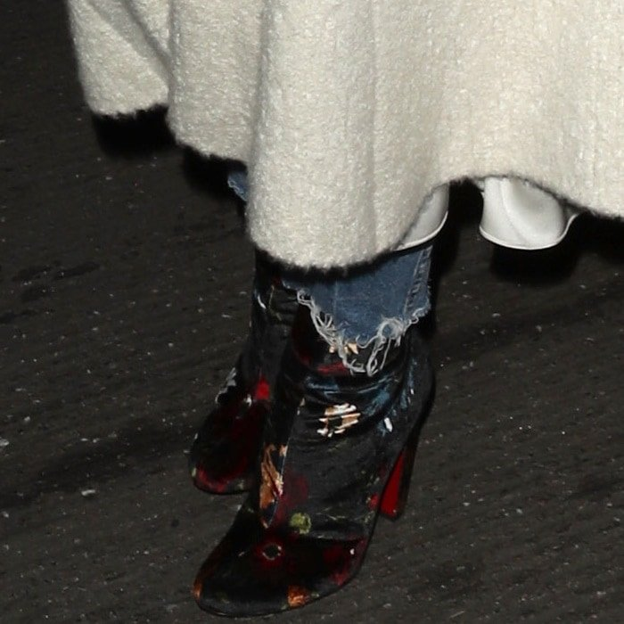 Rosie Huntington-Whiteley wearing floral 'Moulamax' boots from Christian Louboutin