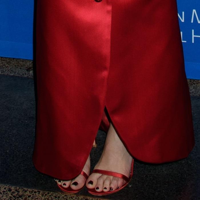 Scarlett Johansson showing off her feet in Stuart Weitzman sandals